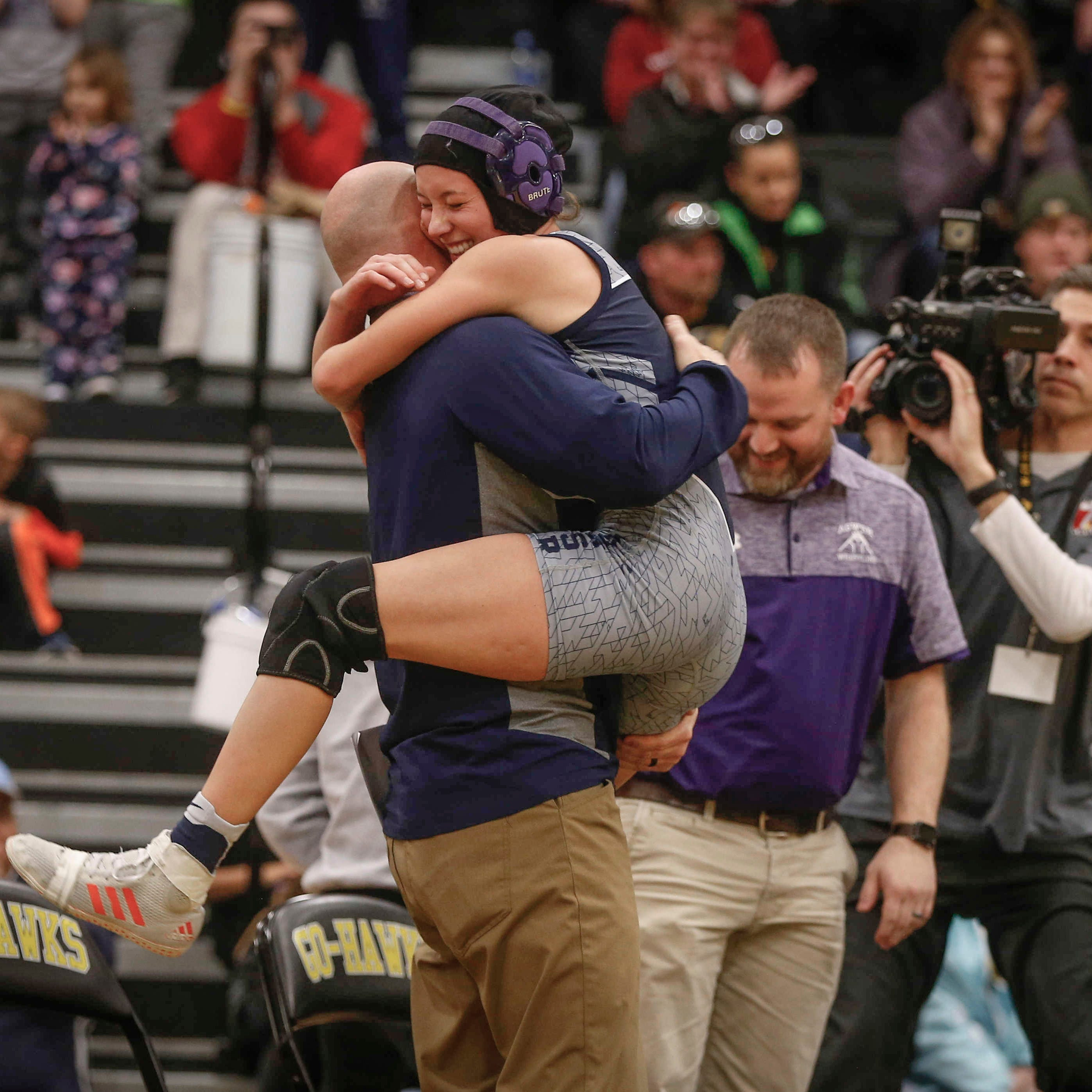 AGWSR junior Ali Gerbracht hugs her coach after...