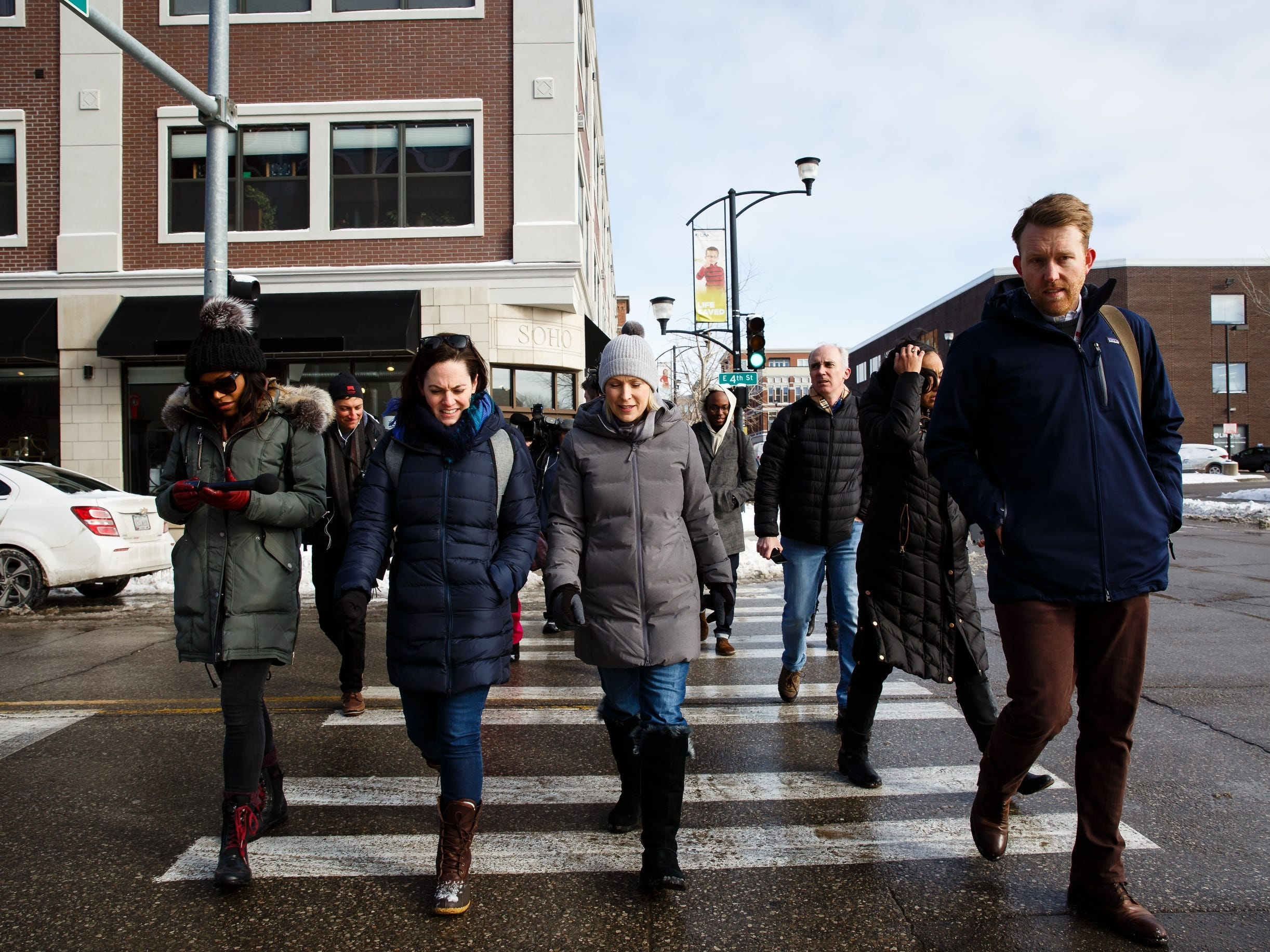 Sen. Kirsten Gillibrand of New York takes a walking tour of the East Village, talking to voters on Saturday, Jan. 19, 2019, in Des Moines.