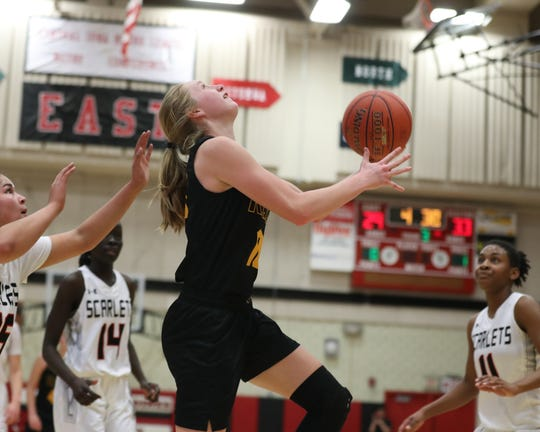 Southeast Polk's Grace Larkins (10) scores on the reverse lay-up against Des Moines East in a game Monday, Jan. 14, at East High School. The Rams won the game 67-47.