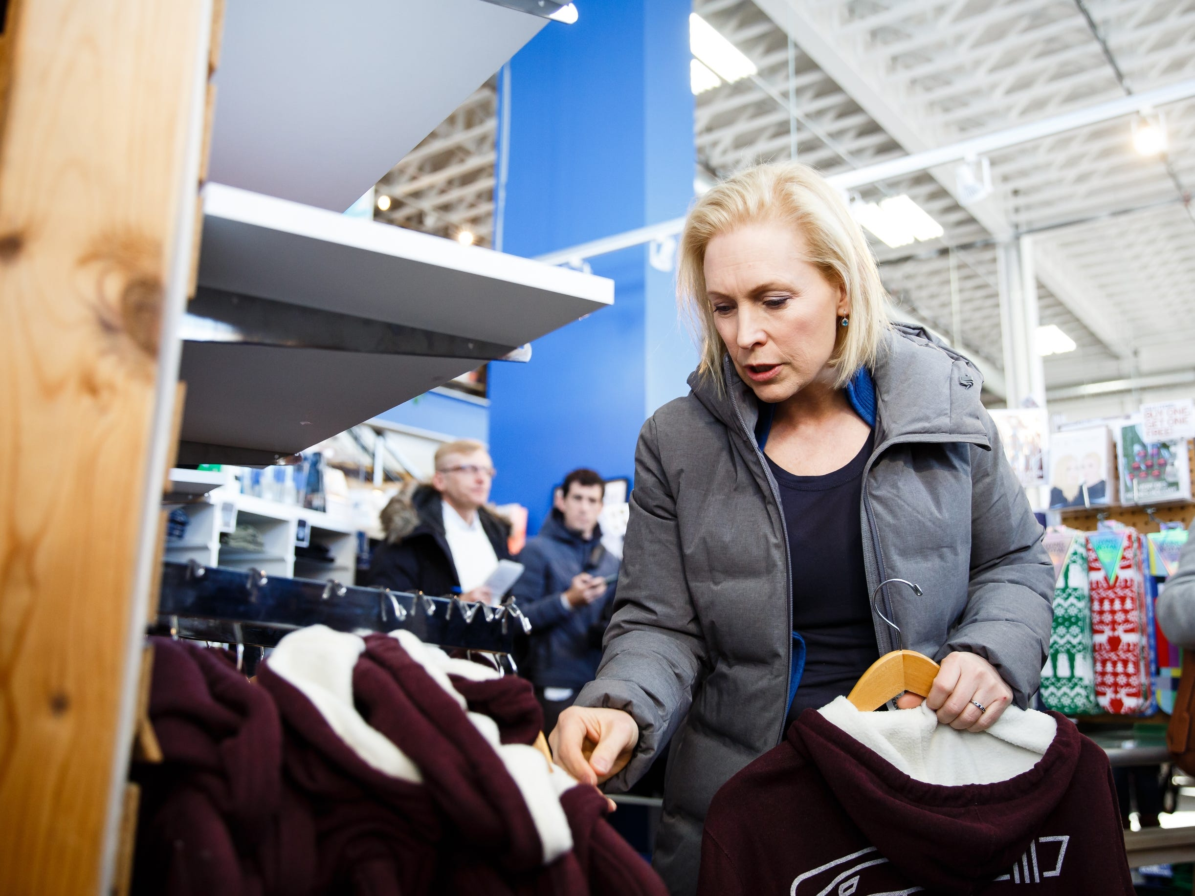 During a walking tour of the East Village, Sen. Kirsten Gillibrand of New York stops at Raygun to look for gifts for her family and talk to voters on Saturday, Jan. 19, 2019, in Des Moines.