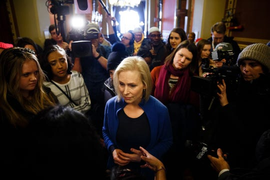 Sen. Kirsten Gillibrand of New York greets voters at the Women's March before taking a walking tour of the East Village and talking to voters on Saturday, Jan. 19, 2019, in Des Moines.