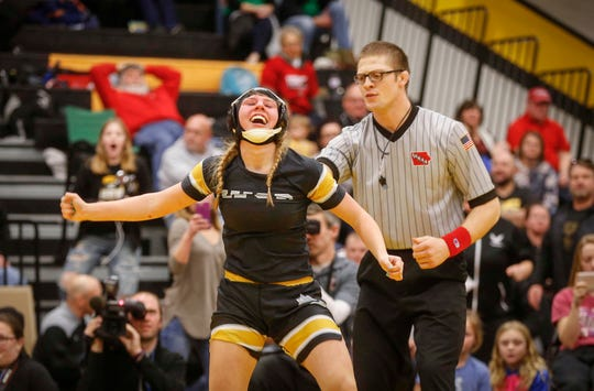 Waverly-Shell Rock freshman Annika Behrends celebrates after winning a state title at 132 pounds over Logan-Magnolia's Olivia Diggins on Saturday, Jan. 19, 2019, during the first Iowa girls state wrestling tournament at Waverly-Shell Rock High School in Waverly.
