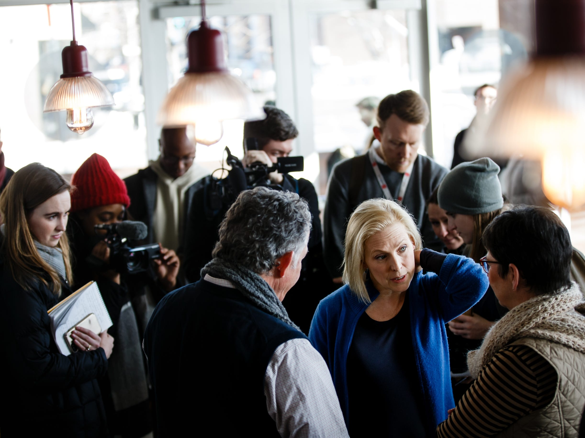 During a walking tour of the East Village, Sen. Kirsten Gillibrand of New York stops at Scenic Route bakery to talk to voters on Saturday, Jan. 19, 2019, in Des Moines.