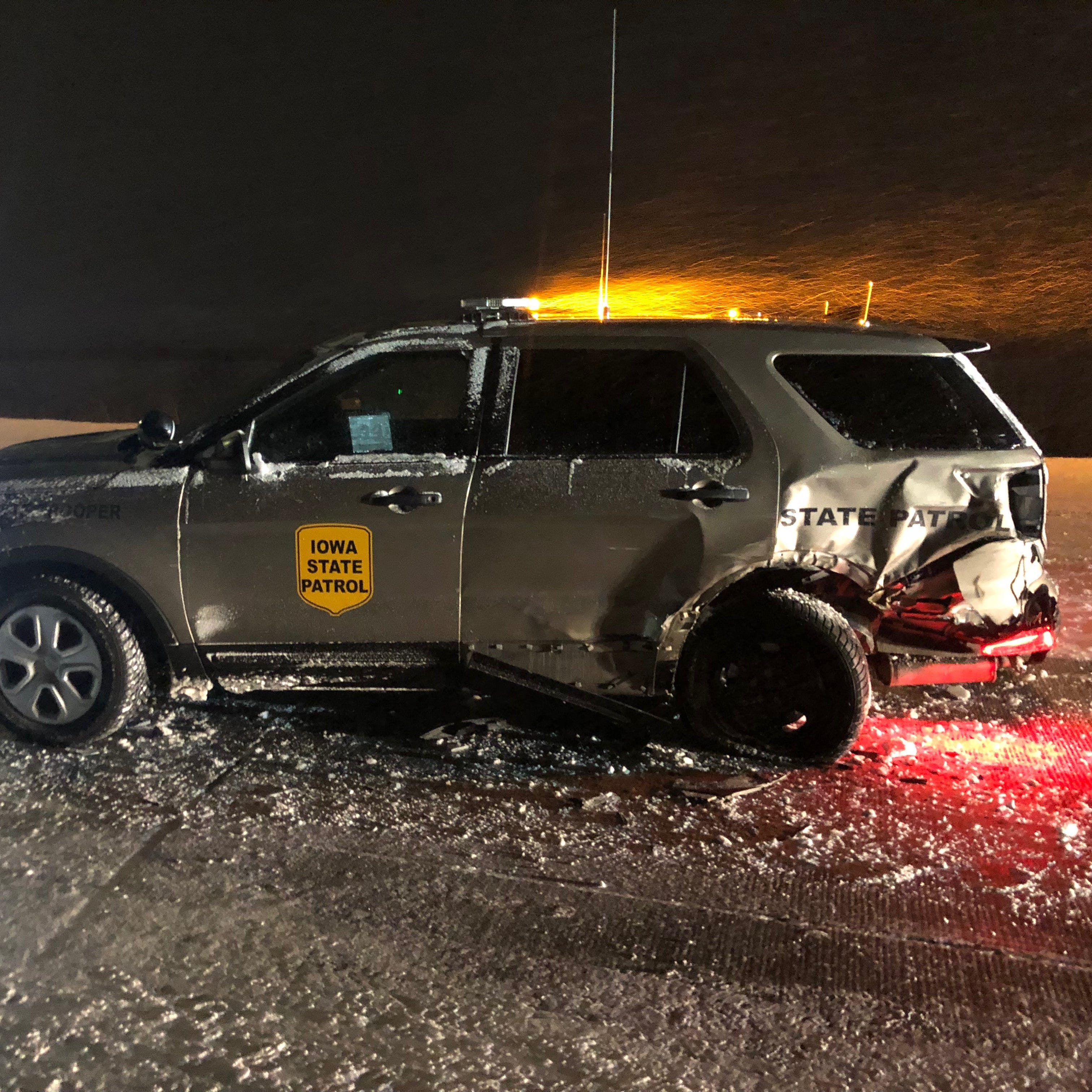 Semitrailer slams into Iowa State Patrol car on Interstate 80, nearly striking trooper