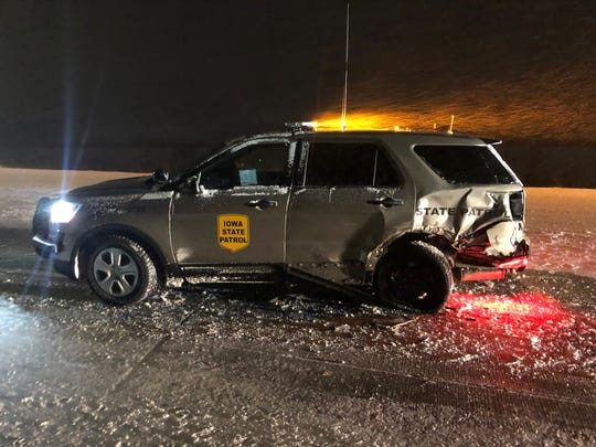 This Iowa State Patrol car was smashed by a semitrailer on Interstate 80 near Mitchellvile during Friday's snowstorm.