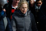Sen. Kirsten Gillibrand of New York leaves the Capitol for a walking tour of the East Village, talking to voters on Saturday, Jan. 19, 2019, in Des Moines.