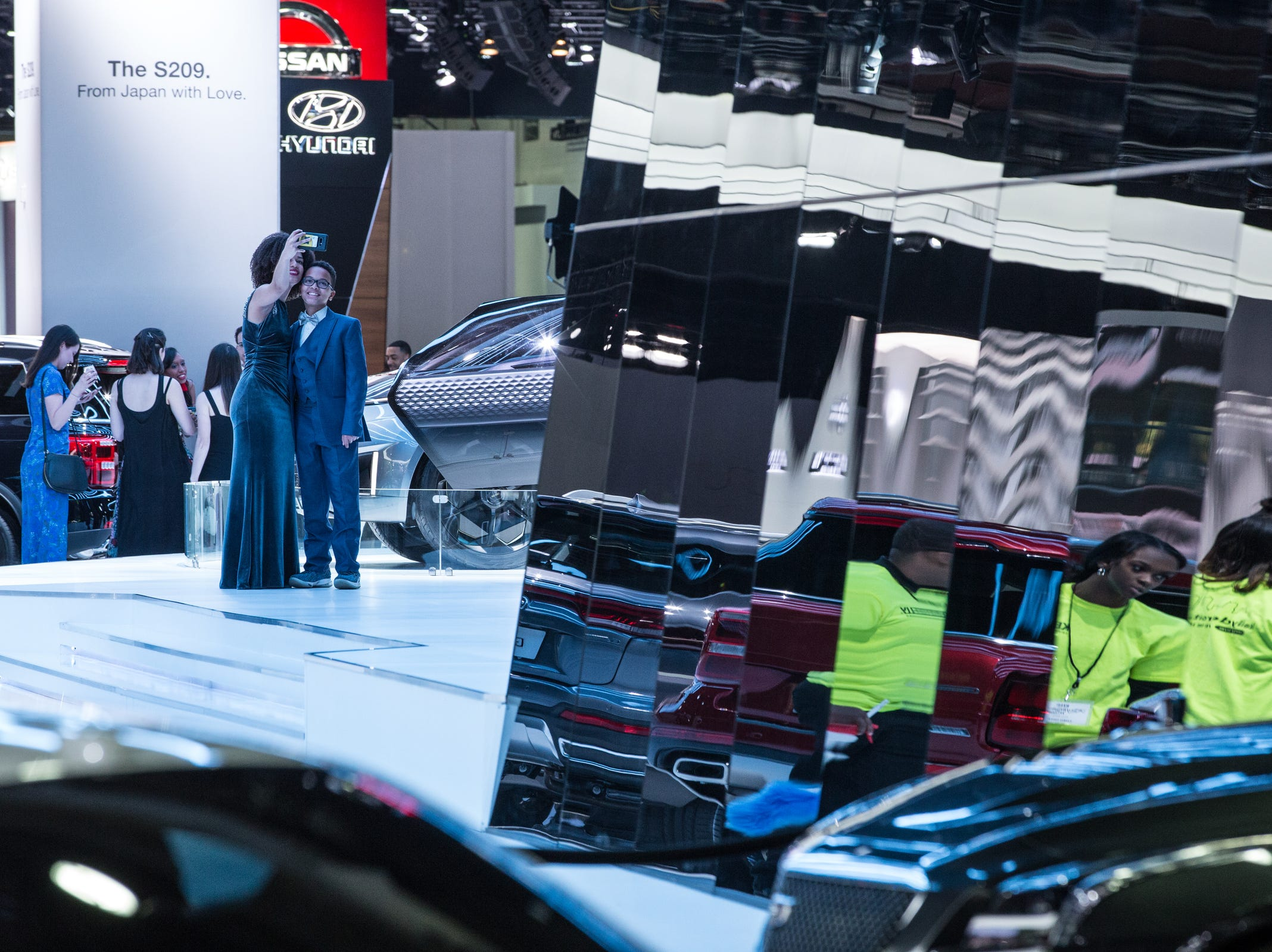 People take a photo in the GAC area during the 2019 North American International Auto Show Charity Preview at Cobo Center in Detroit on Friday, January 18, 2019.