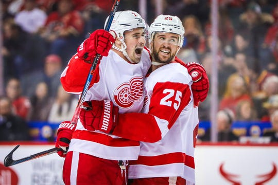 Detroit Red Wings center Dylan Larkin, left, celebrates his goal with defenseman Mike Green in the second period against the Calgary Flames on Friday, Jan. 18, 2019 in Calgary, Alberta.