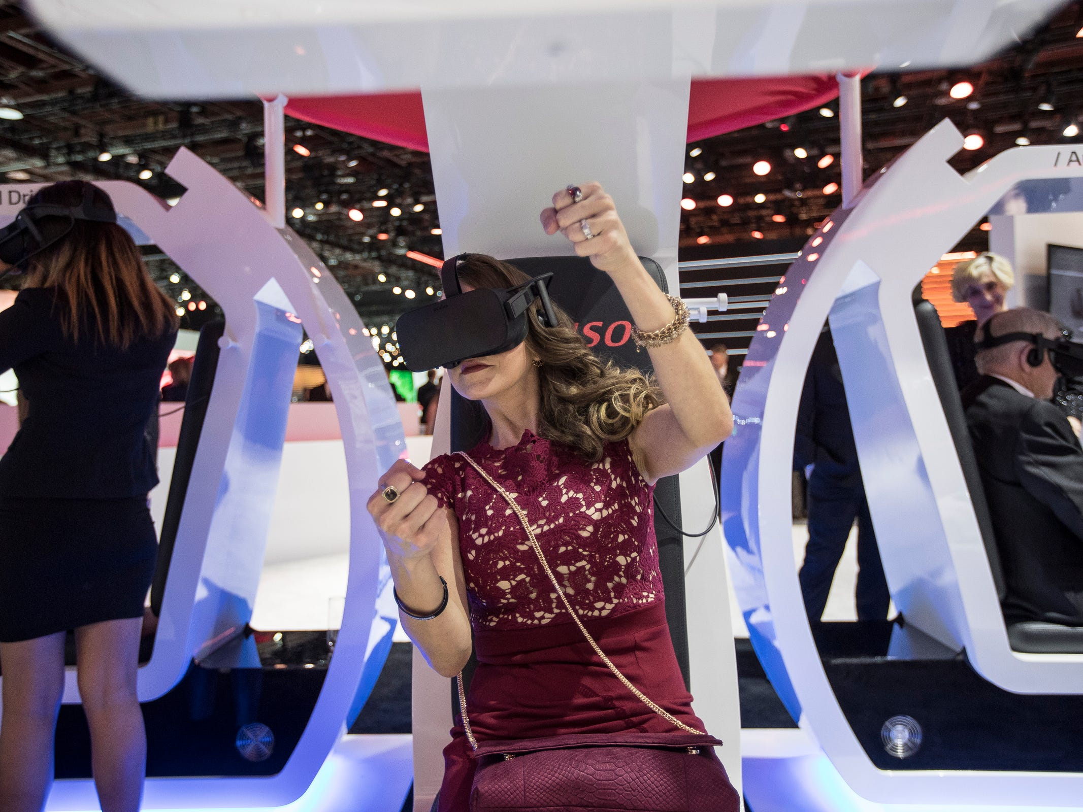 Amber Sharrow of Novi tries on the virtual reality simulation of autonomous drive at Denson during the 2019 North American International Auto Show Charity Preview at Cobo Center in Detroit on Friday, January 18, 2019.
