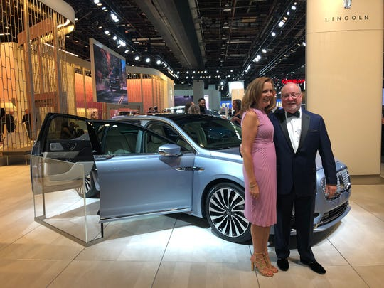 Mike and Donna Oakley of Clinton Township purchased an 80th Anniversary Continental Coach Door Edition. They pose in front of the 2019 model displayed on Jan. 18, 2019 at the Detroit auto show charity preview at Cobo Center.