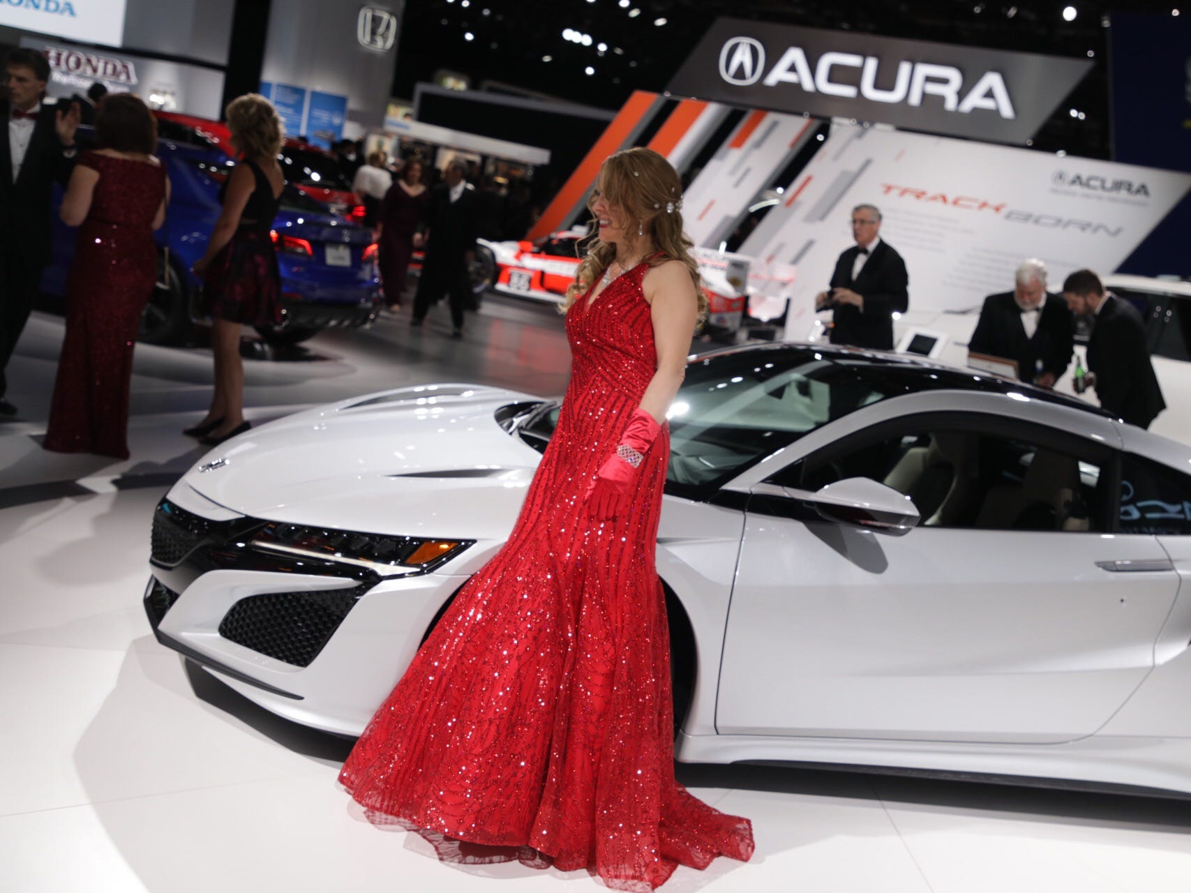 Julie Berry of Clarkston poses with a 2019 Acura NSX during the 2019 North American International Auto Show Charity Preview at Cobo Center in Detroit on Friday, January 18, 2019.