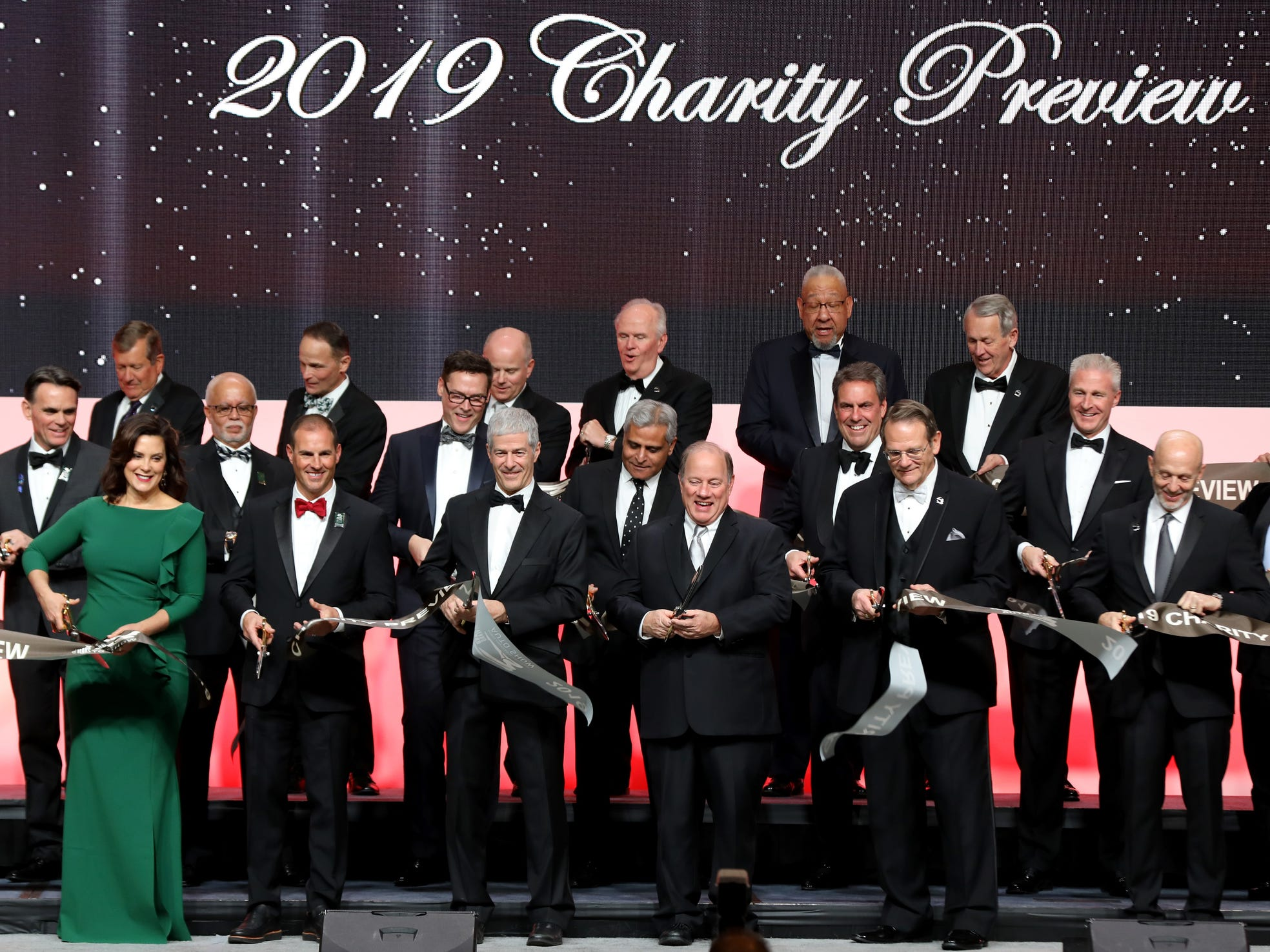 Dignitaries from Governor Gretchen Whitmer to Detroit Mayor Mike Duggan and others cut the ribbon to open the 2019 North American International Auto Show Charity Preview at Cobo Center in Detroit on Friday, January 18, 2019.