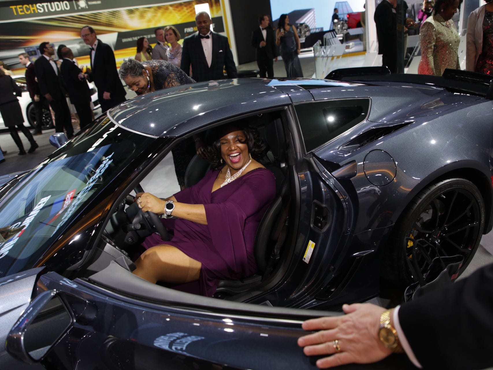 Jackie Tomlin of Southfield sits in a Chevrolet Corvette Grand Sport during the 2019 North American International Auto Show Charity Preview at Cobo Center in Detroit on Friday, January 18, 2019.