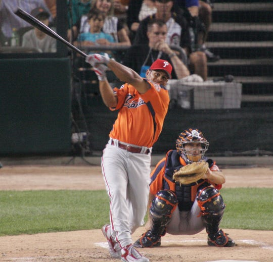 Bobby Abreu watches one of his 11 home runs in the final round  of  the  Home Run Derby on  July 11, 2005 at Comerica Park. Abreu hit a total of 41 home runs for the night.