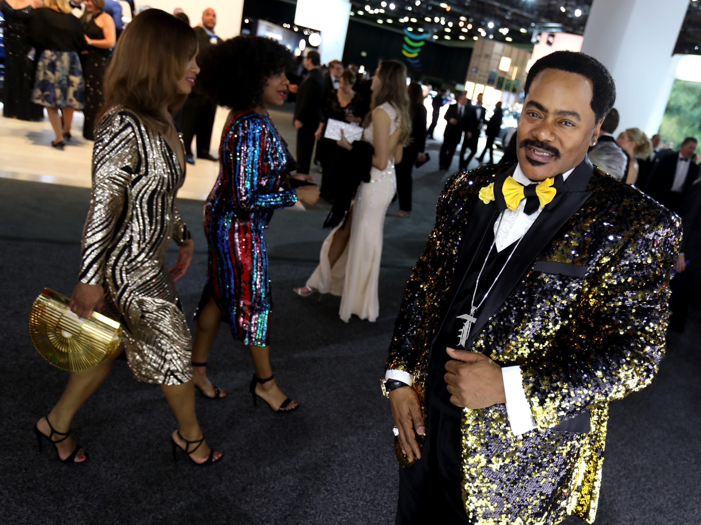 Thomas Bolden of Detroit chose a gold and black sequined jacket to wear during the 2019 North American International Auto Show Charity Preview at Cobo Center in Detroit on Friday, January 18, 2019.