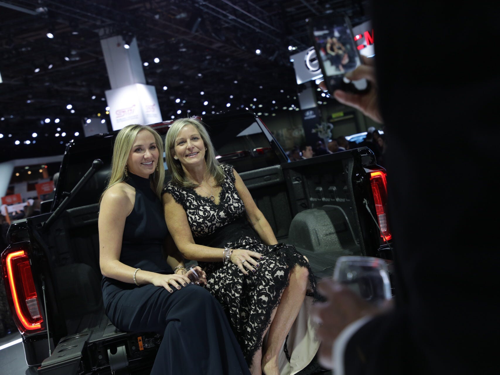 Sheri Walworth, right and her daughter Lindsey Walworth pose for a photograph in the back of a GMC Denali Sierra truck during the 2019 North American International Auto Show Charity Preview at Cobo Center in Detroit on Friday, January 18, 2019.