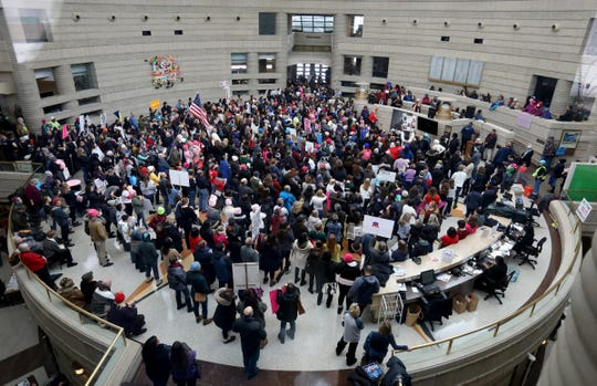 A large crowd listens to a variety of speakers during the Women's March and rally inside the Ford Rotunda inside the Charles H. Wright Museum of African American History in Detroit on Saturday, January 19, 2019.