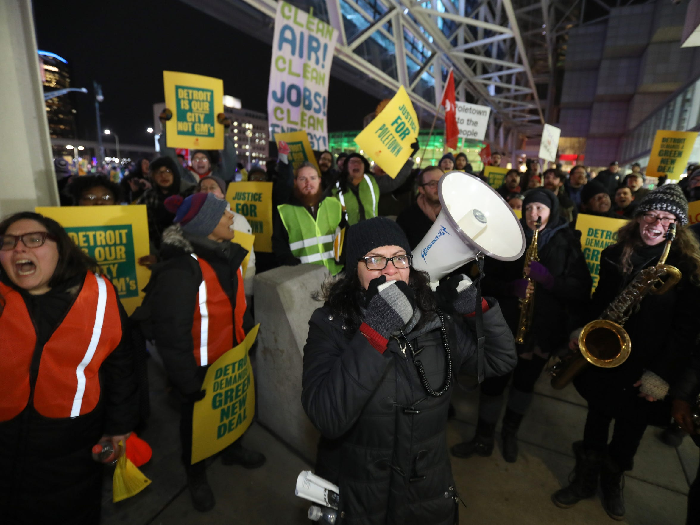 Using a bullhorn, Rep Rashida Tlaib who represents Michigan's 13th district in Congress talks with the GM Poletown protestors outside Cobo Center during the start of the 2019 North American International Auto Show Charity Preview at Cobo Center in Detroit on Friday, January 18, 2019.