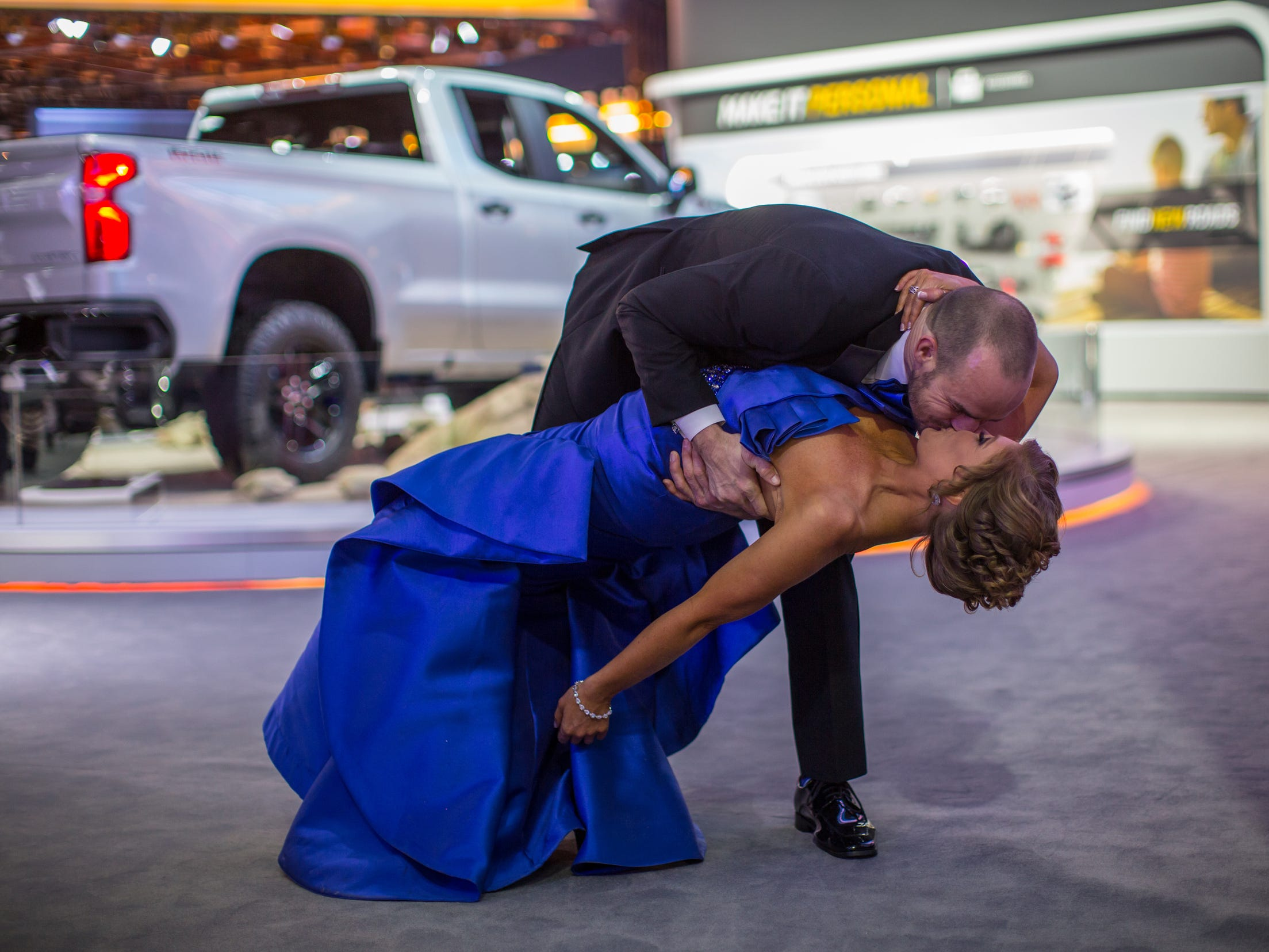 Marie Anderson of Clinton Township is dipped for a photo by Brian Rush of East Lansing during the 2019 North American International Auto Show Charity Preview at Cobo Center in Detroit on Friday, January 18, 2019.