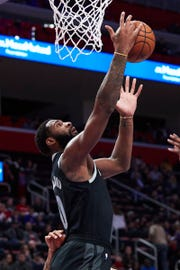 Detroit Pistons center Andre Drummond grabs the rebound in the first half against the Miami Heat at Little Caesars Arena, Friday, Jan. 18, 2019, in Detroit.
