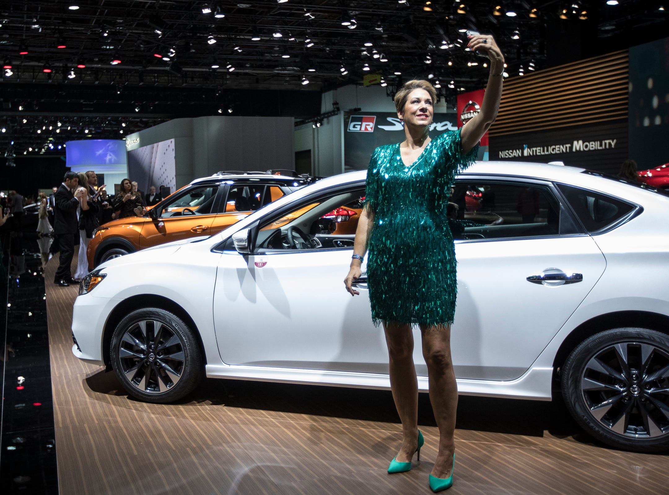 Kelley Stodulski of Beverly Hills takes a selfie next to 2019 Nissan Sentra during the 2019 North American International Auto Show Charity Preview at Cobo Center in Detroit on Friday, January 18, 2019.