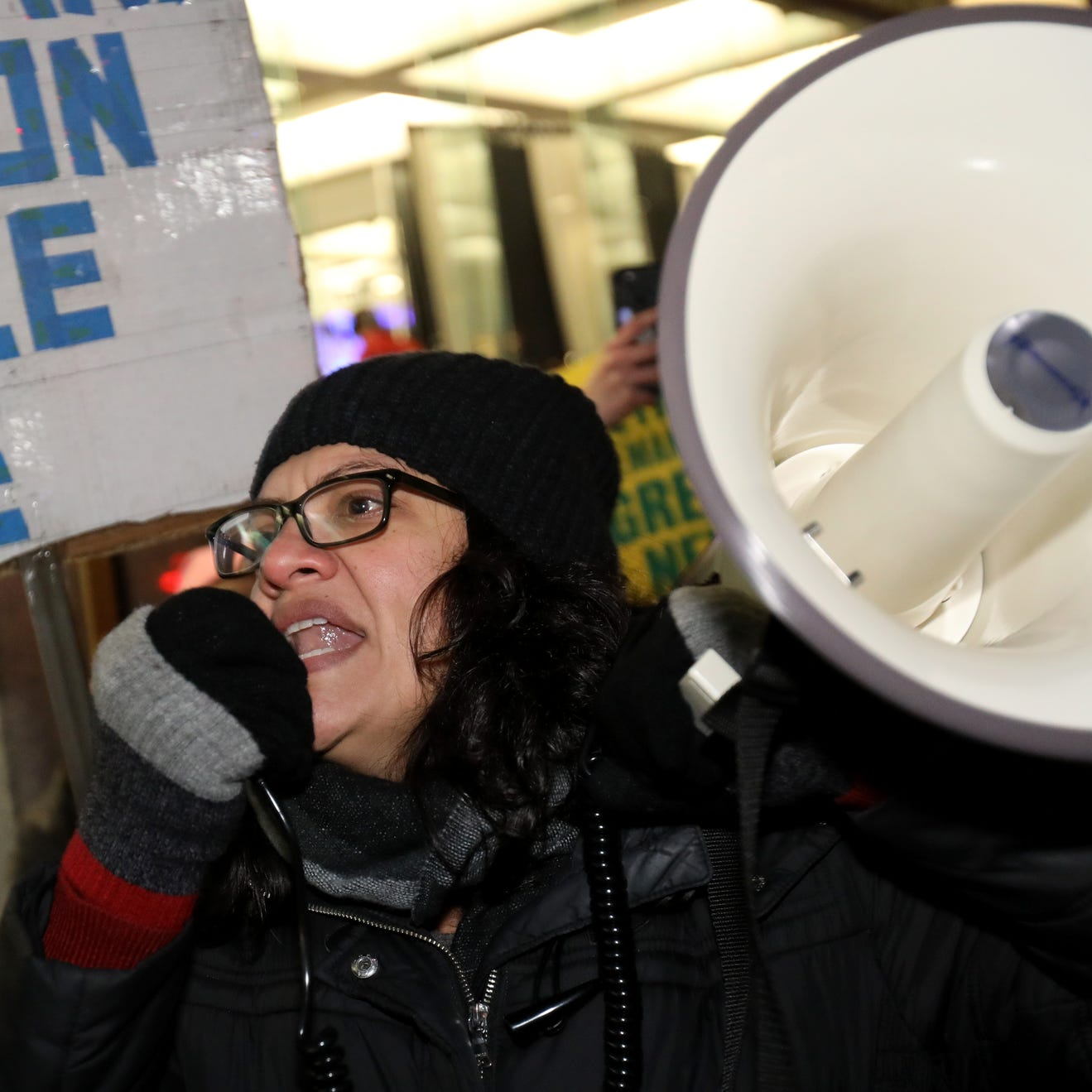 Rep. Tlaib to protesters: 'Let's march on, while they sip champagne'