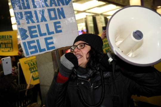 Using a bullhorn, Rep Rashida Tlaib protests with the GM Detroit-Hamtramck plant protesters outside Cobo Center during the start of the 2019 North American International Auto Show Charity Preview.