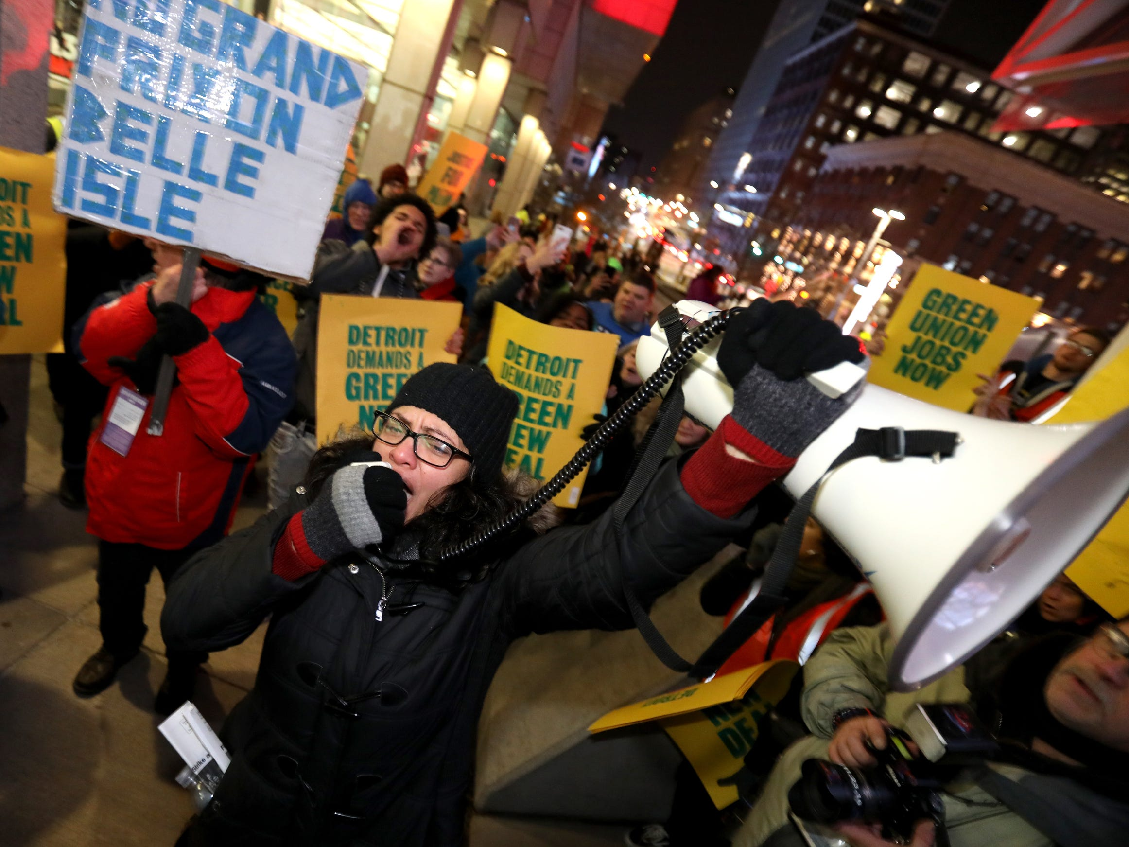 Using a bullhorn, Rep Rashida Tlaib who represents Michigan's 13th district in Congress talks with the GM Poletown protestors outside Cobo Center during the start of the 2019 North American International Auto Show Charity Preview at Cobo Center in Detroit on Friday, January 18, 2019. Over 300 protestors were outside as Charity Preview attendees went inside the event.