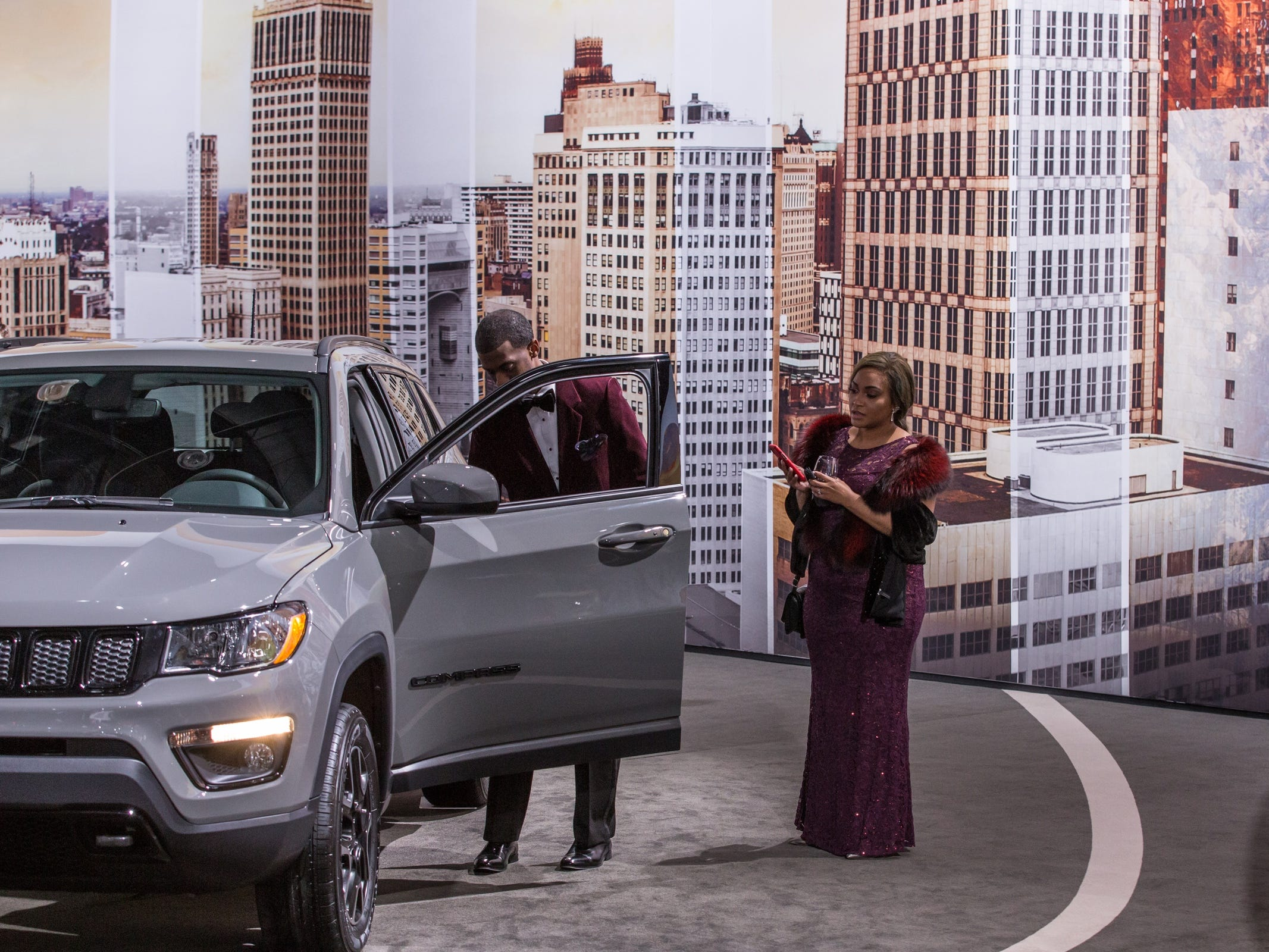 People look over the Jeep vehicles during the 2019 North American International Auto Show Charity Preview at Cobo Center in Detroit on Friday, January 18, 2019.