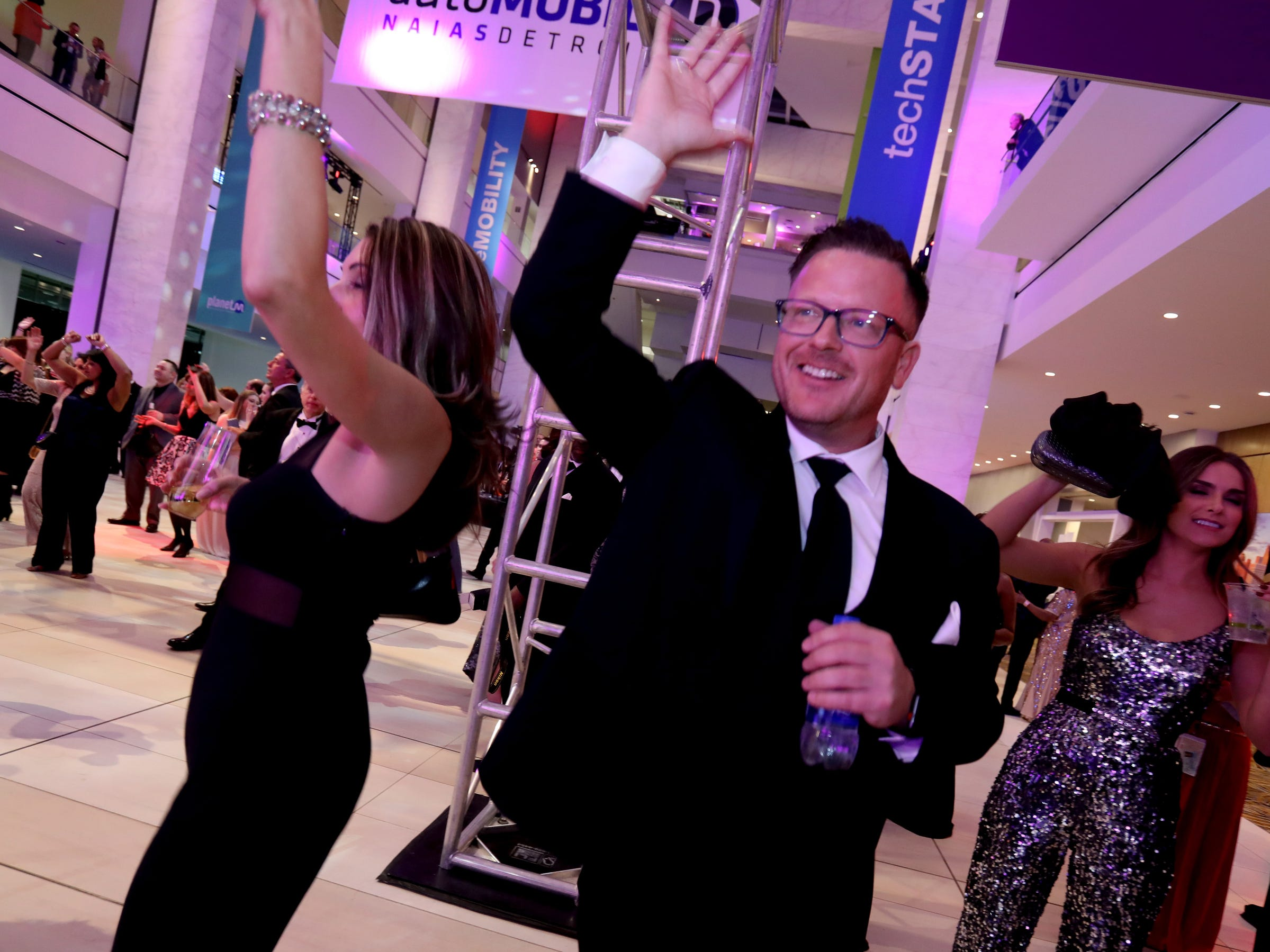 (L to R) Rebecca Kuta and Teddy Deming of Flushing, Michigan dance to Your Generation as they perform for the 2019 North American International Auto Show Charity Preview crowd at Cobo Center in Detroit on Friday, January 18, 2019.