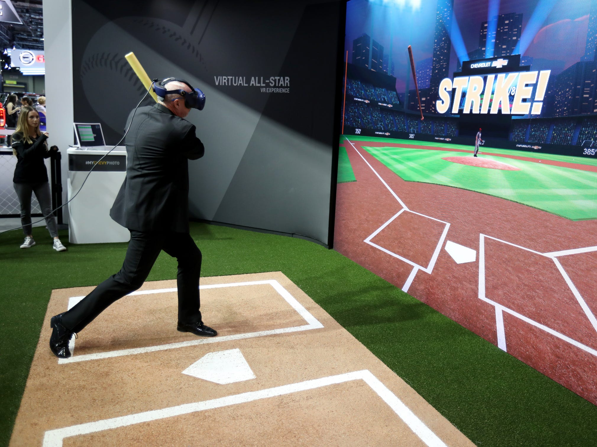 Ted Ens, of Sand Point, Michigan strikes out during a baseball virtual reality game near the GM exhibit during the 2019 North American International Auto Show Charity Preview at Cobo Center in Detroit on Friday, January 18, 2019.