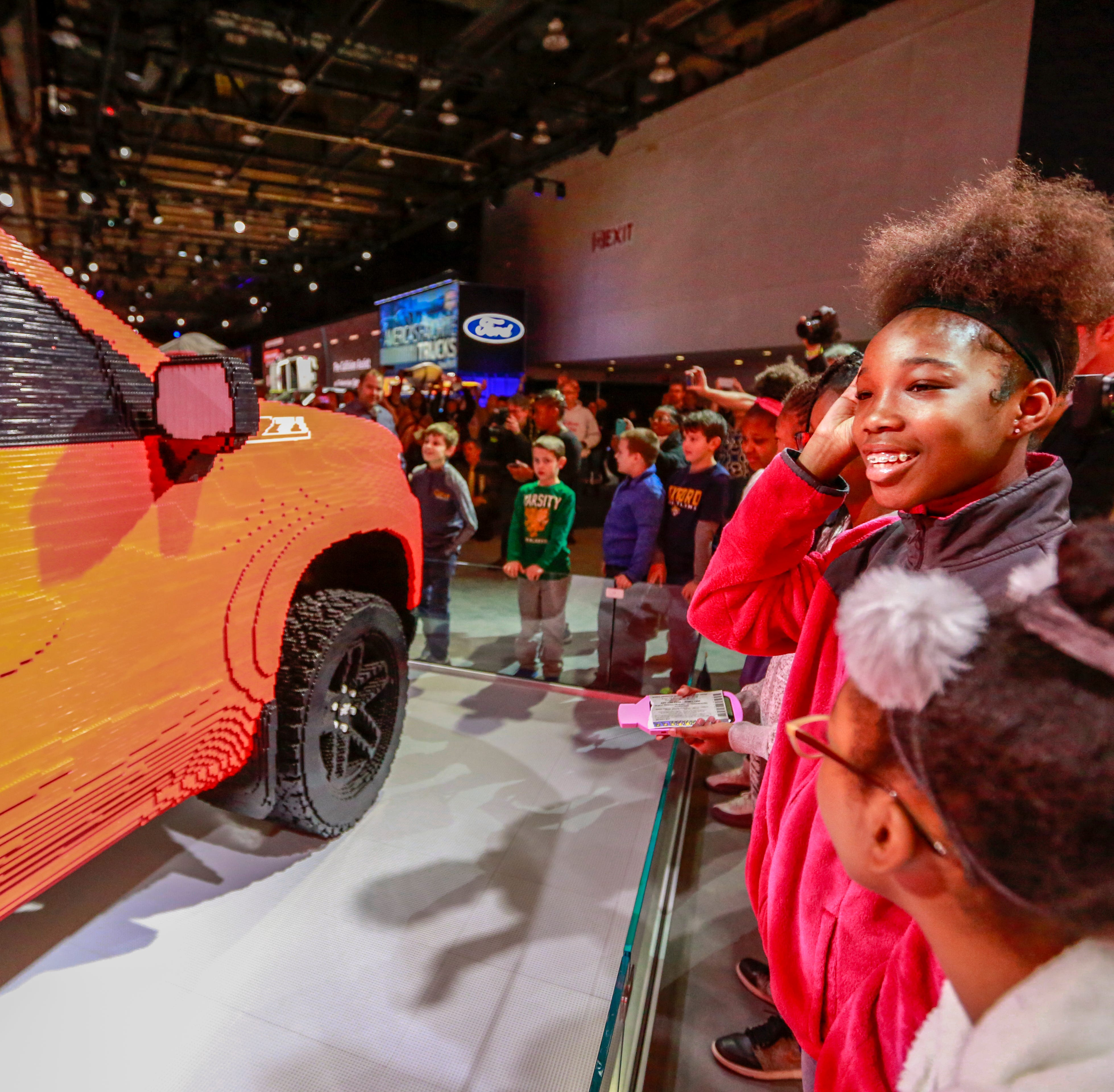 Chevrolet unveils first full-size LEGO Silverado to students at auto show