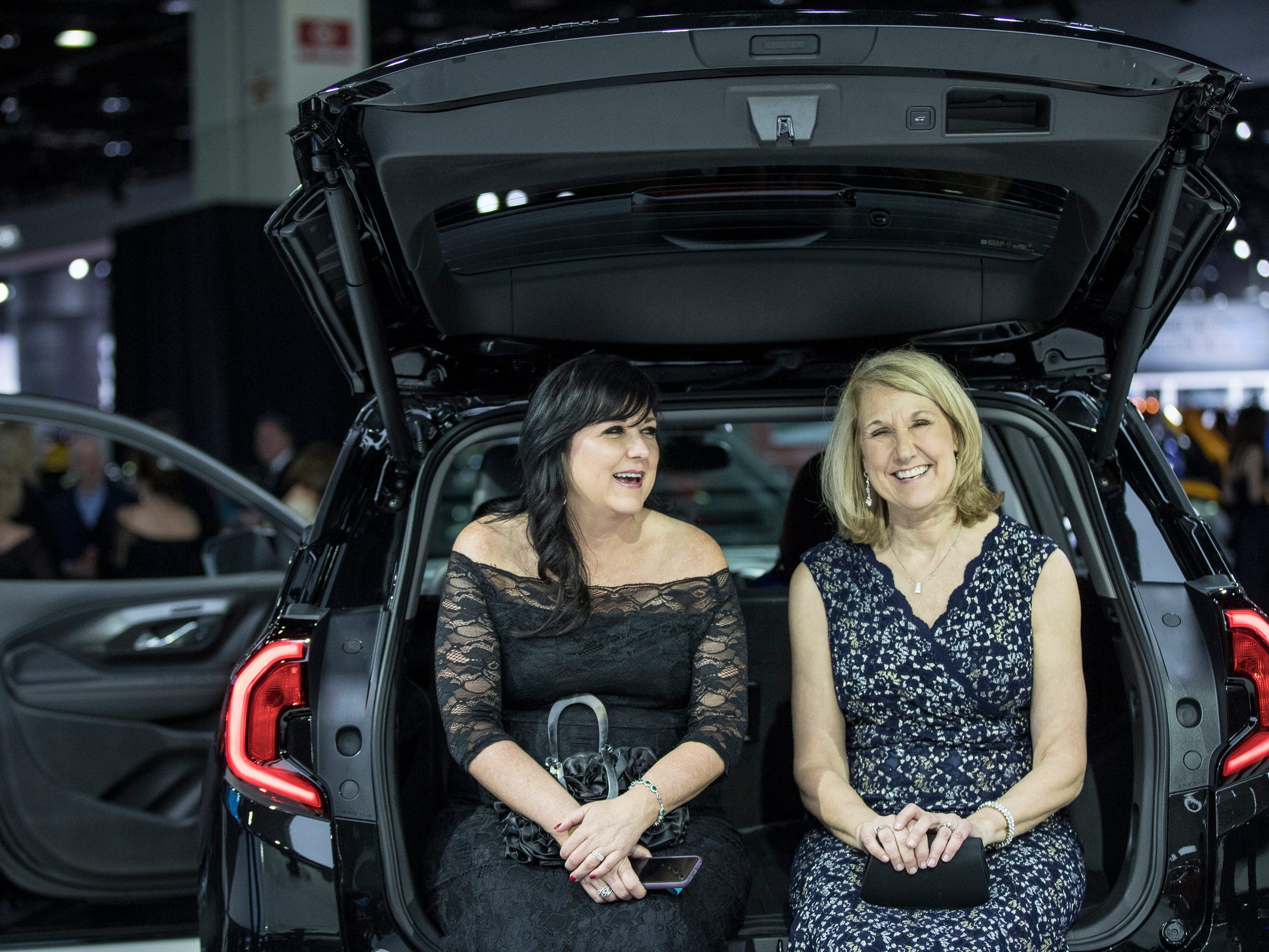 Tina Ireland of Phoenix, Ariz. and Cindy Brosious of Detroit share a laughter in the back of a 2019 GMC Terrain during the 2019 North American International Auto Show Charity Preview at Cobo Center in Detroit on Friday, January 18, 2019.