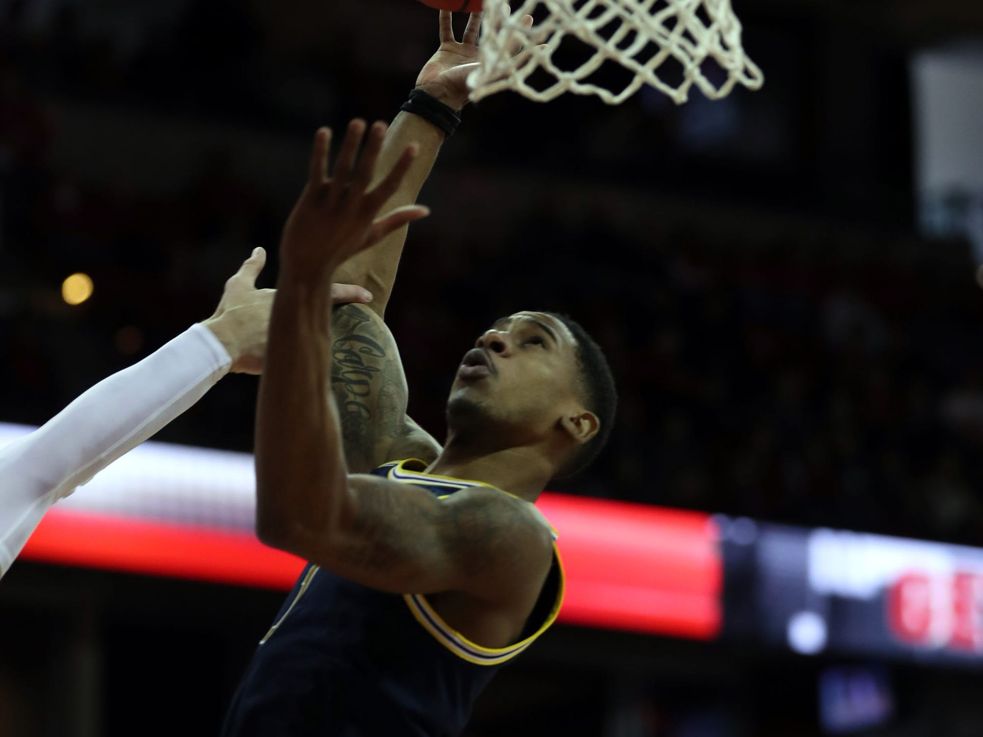 Michigan Wolverines guard Charles Matthews takes the ball to the basket against the Wisconsin Badgers at the Kohl Center, Jan. 19, 2019.