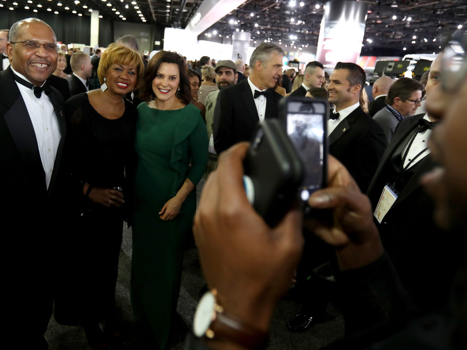 (L to R) Mark and Rosa Adams found Governor Gretchen Whitmer and wanted their picture taken with her as they walked around the 2019 North American International Auto Show Charity Preview at Cobo Center in Detroit on Friday, January 18, 2019.