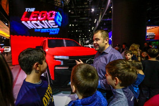 Sandor Piszar, director of Chevrolet Truck Marketing, talks to students from Ralph Waldo Emerson Elementary-Middle school and Oxford Community Schools about the 2019 Chevrolet Silverado 1500 Trail Boss made entirely out of LEGOs they just revealed, during the first public day of the North American International Auto Show at Cobo Center in downtown Detroit on Saturday, Jan. 19, 2019.