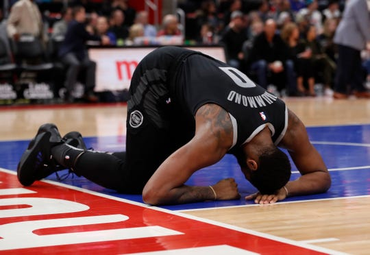 Andre Drummond reacts after taking a shot to the face against the Heat, Friday at LCA.