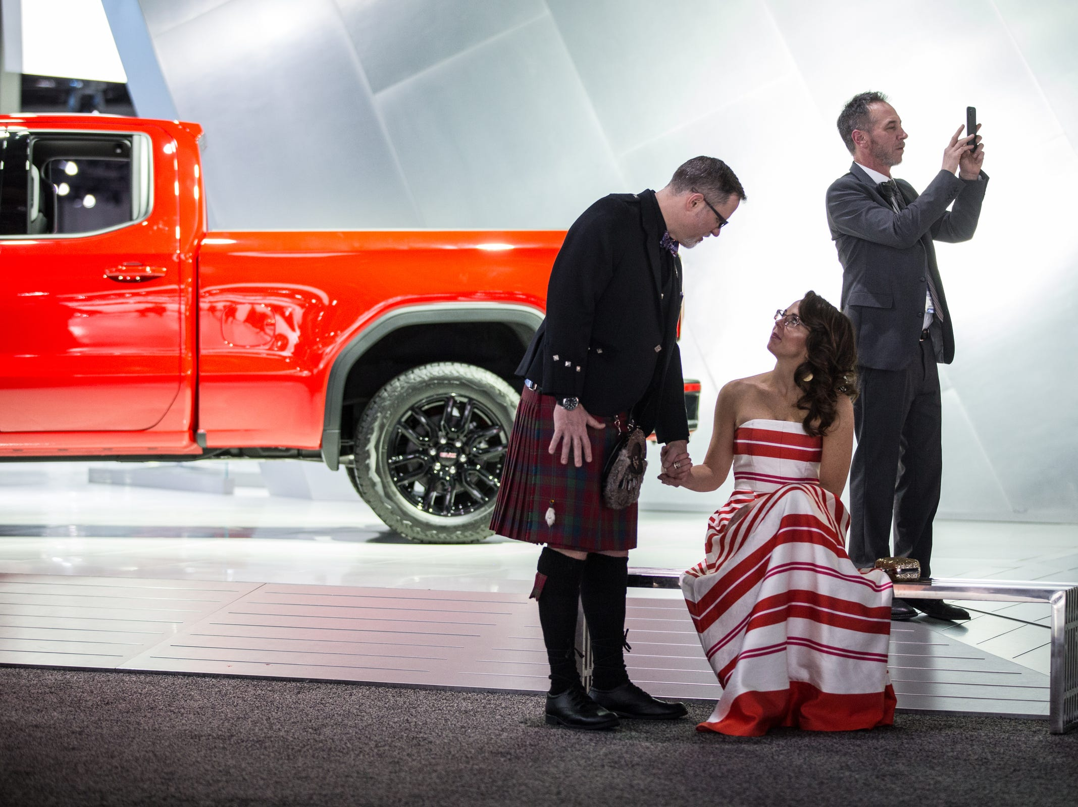 Steve Sechrist of Wixom and his wife Stacey Sechrist talk while taking a rest during the 2019 North American International Auto Show Charity Preview at Cobo Center in Detroit on Friday, January 18, 2019.