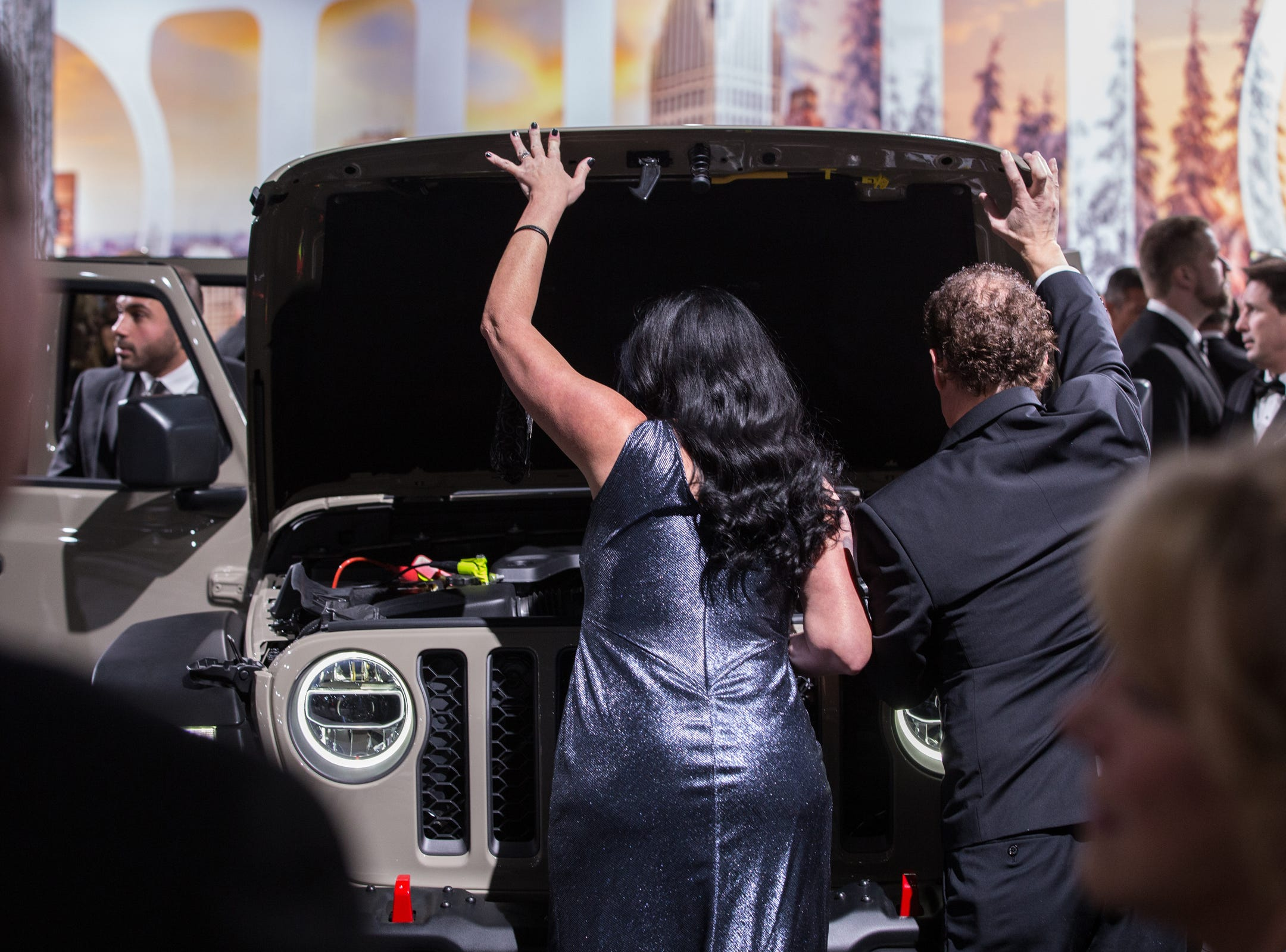 Rebecca Whitney and her husband Rick Whitney of Beverly Hills look under the hood of a Jeep Gladiator during the 2019 North American International Auto Show Charity Preview at Cobo Center in Detroit on Friday, January 18, 2019.