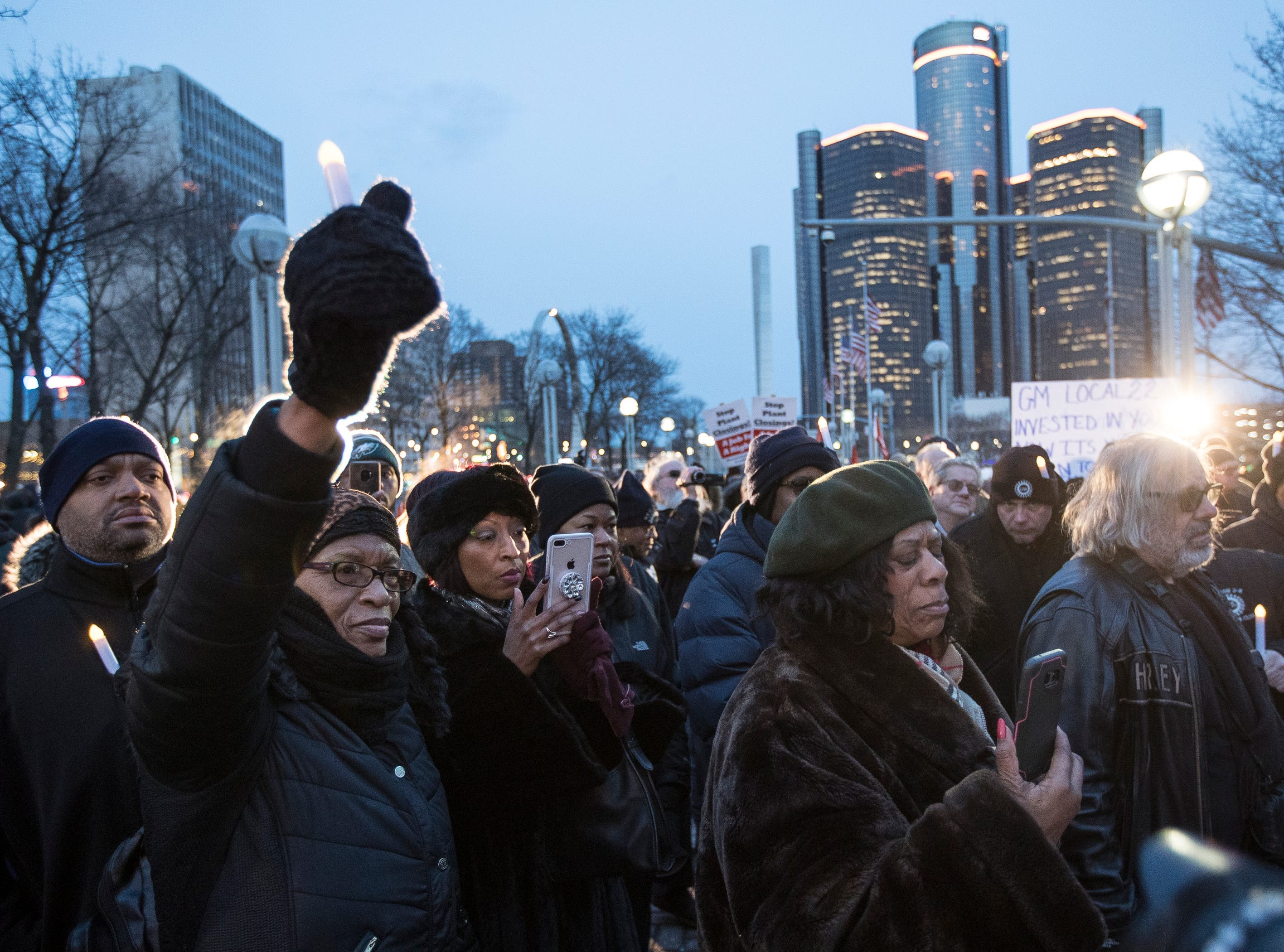 Ernestine Howse, left, holds her candle up as she listen to UAW local 900 Chaplin Philip Jackson speaks during the UAW pre-charity preview candlelight vigil at the Hart Plaza in Detroit on Friday, January 18, 2019. Alberta Tinsley Talabi (D) State Representative, District 2 is pictured in green hat.