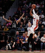 Dwyane Wade shoots over Ish Smith in the first half.