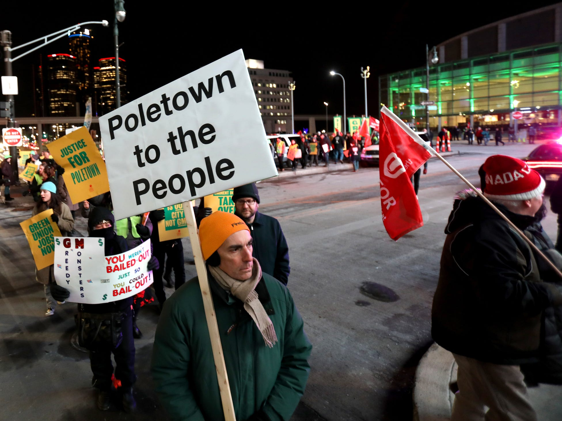 Protestors against General Motors march in front of Cobo Center during the 2019 North American International Auto Show Charity Preview on Friday, January 18, 2019.