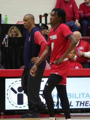 Detroit coach Mike Davis, left, has previously coached against Michigan State as the head coach at Indiana and Texas Southern . His son, Antoine Davis, right, is the Titans' star.