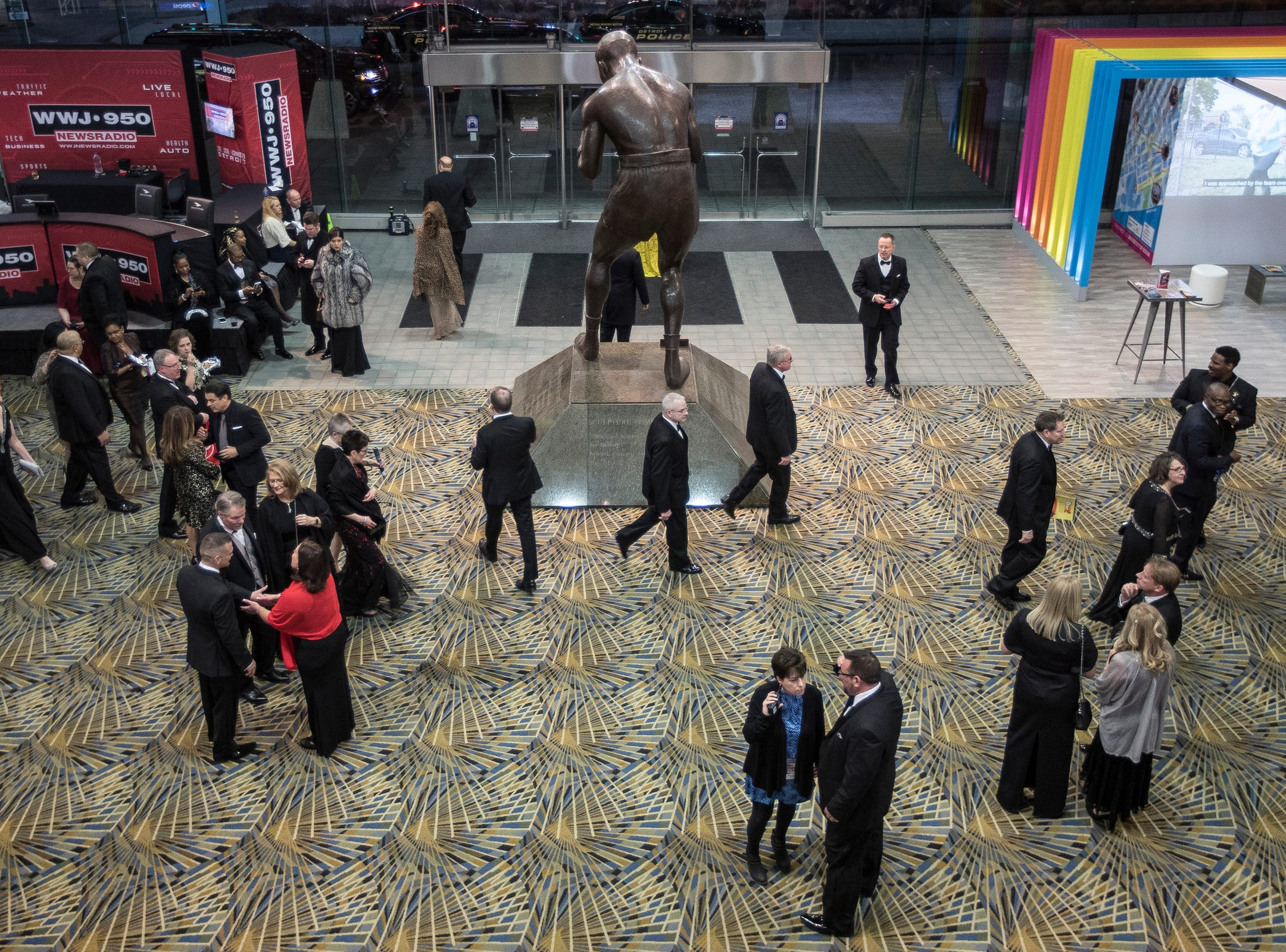People walk by the Joe Louis statue during the 2019 North American International Auto Show Charity Preview at Cobo Center in Detroit on Friday, January 18, 2019.