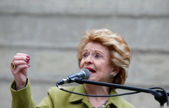 Sen. Debbie Stabenow talks to a crowd of people gathered for the Women's March and rally inside the Ford Rotunda inside the Charles H. Wright Museum of African American History in Detroit on Saturday, January 19, 2019.