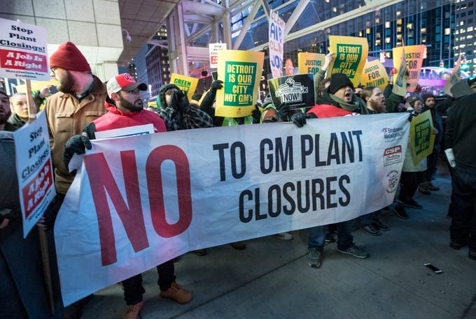Protesters gather outside of Cobo Center to protest GM's plant closure during the NAIAS charity preview in Detroit on Friday, January 18, 2019.