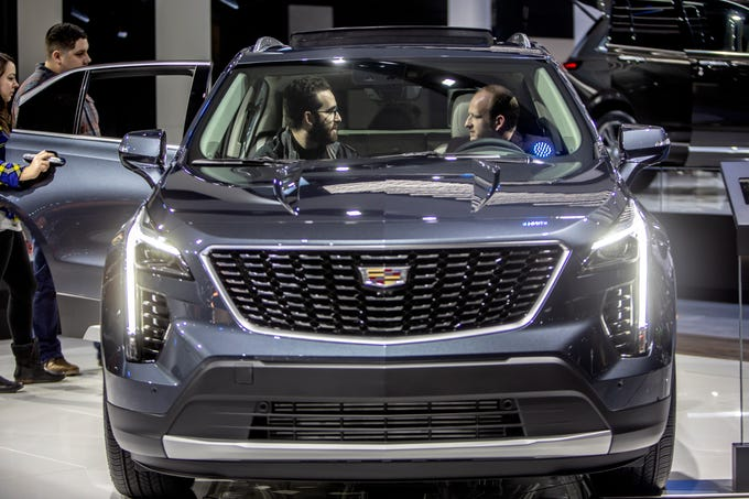 Jeremy Spira, 26, of Toronto, left, sits in the 2019 Cadillac XT4 with Jon Markowski, 26, of Toronto, during the start of the North American International Auto Show at Cobo Center in downtown Detroit on Saturday, Jan. 19, 2019.