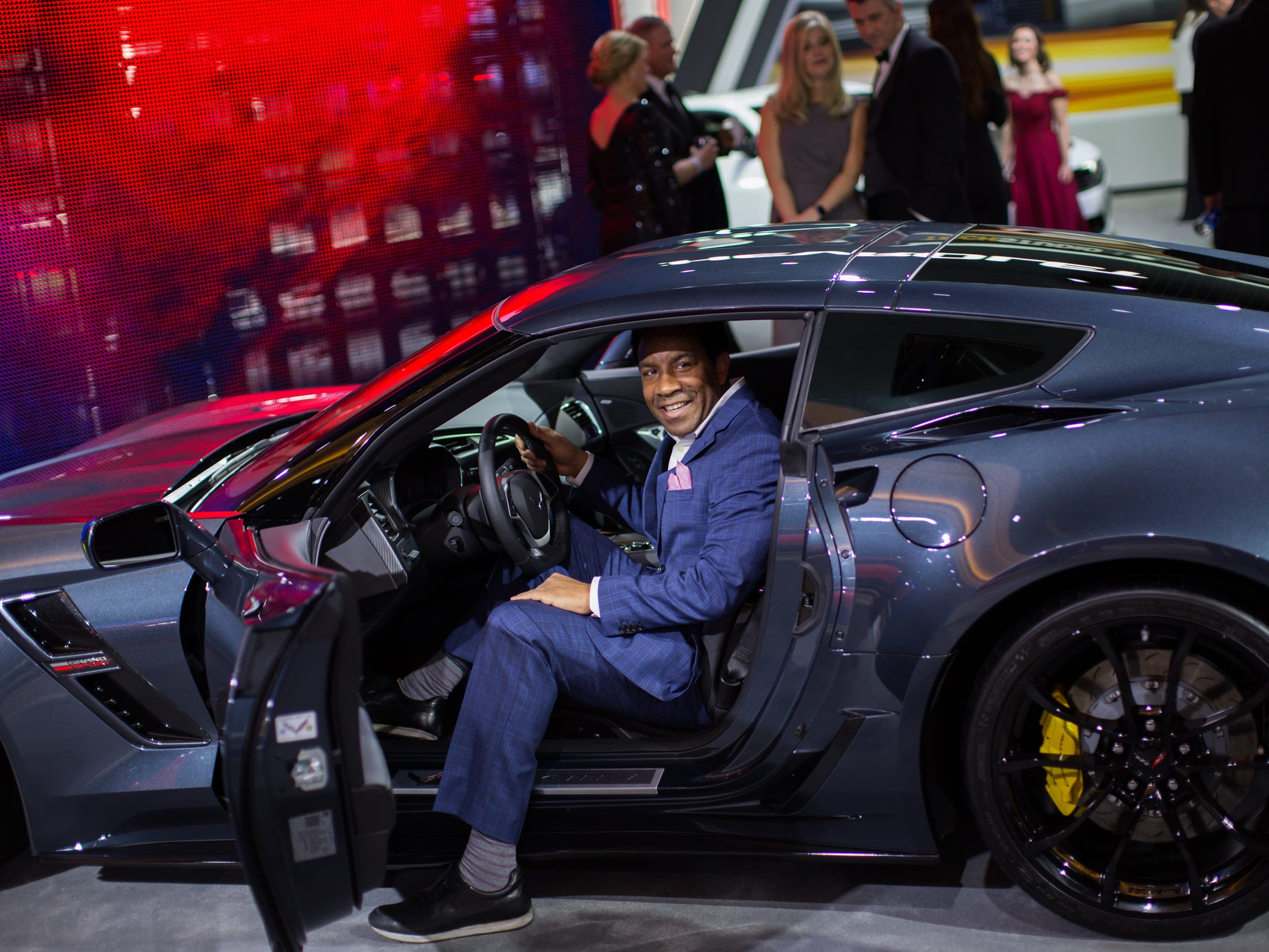 John Vasquez of Miami sits in Chevrolet Corvette during the 2019 North American International Auto Show Charity Preview at Cobo Center in Detroit on Friday, January 18, 2019.