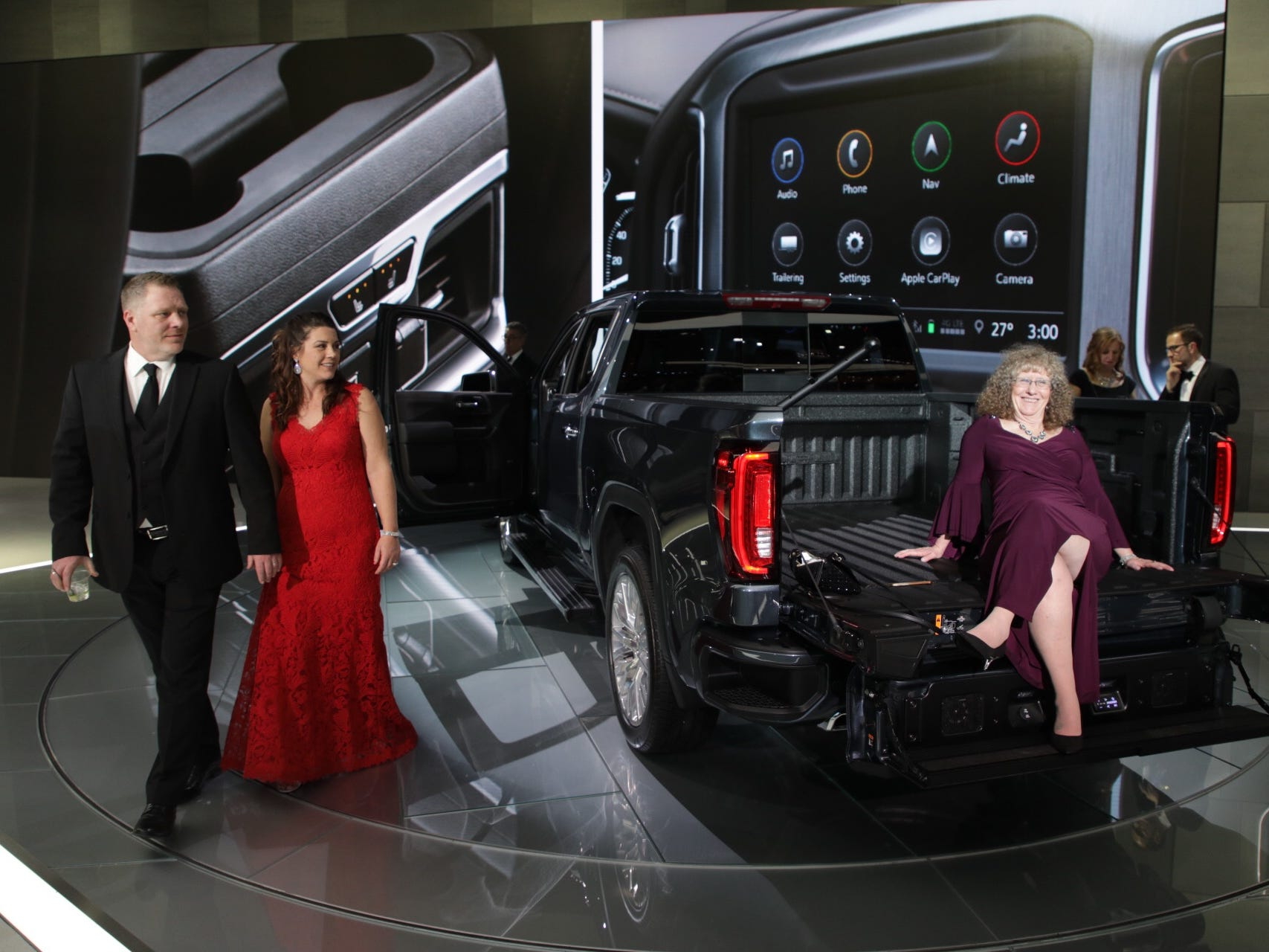 Kristen Moran of Beverly Hills poses for a photograph in the back of a Denali truck during the 2019 North American International Auto Show Charity Preview at Cobo Center in Detroit on Friday, January 18, 2019.