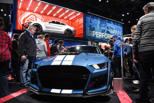 People admire the 2020 Ford Mustang Shelby GT500 at Cobo Center on Saturday, January 19, 2019.